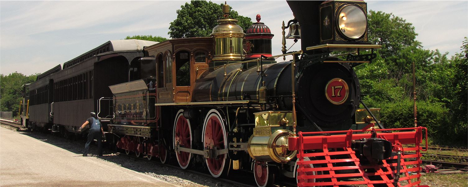 Historical steam engine on railroad tracks